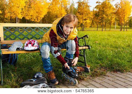 Boy Lacing Roller Skates