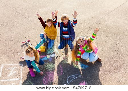 Friends Having Fun With Chalk