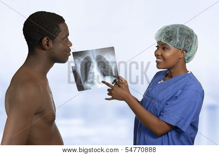 African Doctor Explaining X-ray Image To Patient