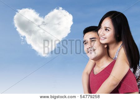 Happy Couple Looking At The Clouds Love