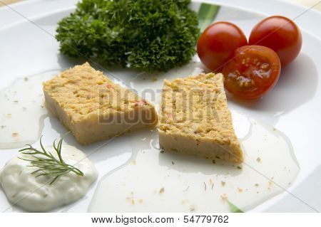 Fish Pie Slices On A Plate With Salad