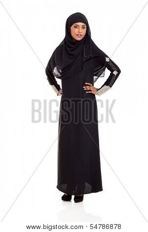 attractive young muslim woman standing on white background