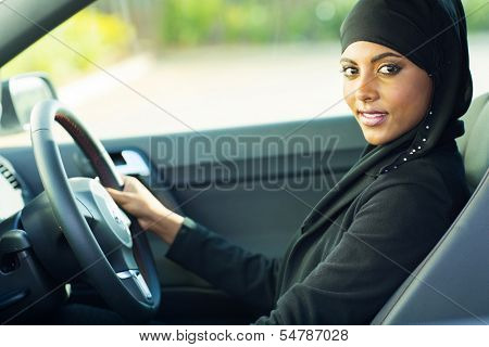 beautiful modern muslim woman in a car
