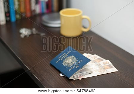 Brazilian Passport And Brazilian Currency (real)