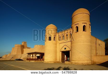 Western gate (Ata Darvoza) to ancient town of Itchan Kala at sunset. The city of Khiva, Uzbekistan
