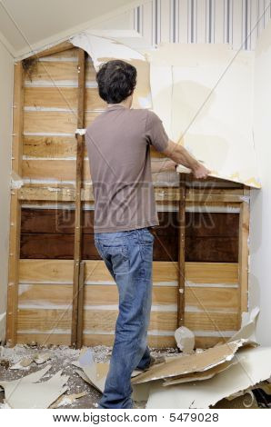 Man Doing Renovation Work To House
