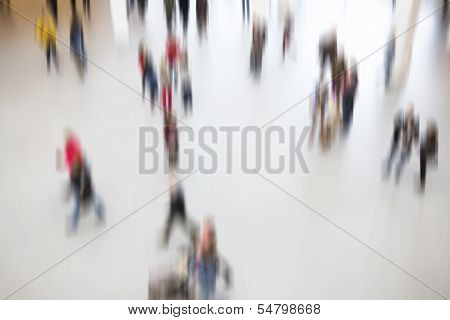 Groups of people moving around, blurry