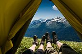 stock photo of boot camp  - a couple camping in mountains view from a tent - JPG