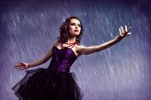 stock photo of dancing rain  - Young woman dancing for her abstract background - JPG