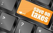 image of irs  - save on taxes word on laptop keyboard key business concept - JPG