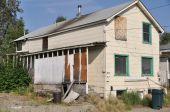stock photo of abandoned house  - Abandoned home in small town America June 2009 - JPG