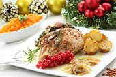 stock photo of christmas meal  - dish of roasted turkey breast on a christmas table - JPG