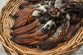 picture of festering  - Bunch of rotten banana in basket on floor - JPG