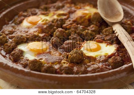 Moroccan kefta tagine with eggs (Mkaouara) close up