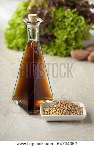 Sesame oil and roasted sesame seeds to use for a dressing