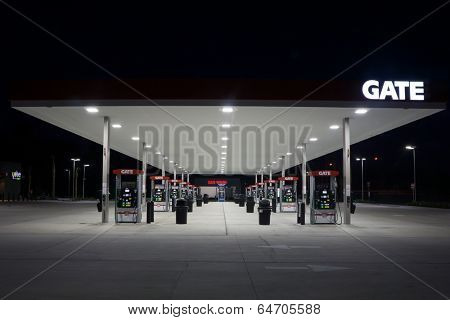 JACKSONVILLE, FL - MAY 8, 2014: A Gate Petroleum gas station at night in Jacksonville. Gate Petroleum is headquartered in Jacksonville and has over 225 gas stations with over 2,200 employees.