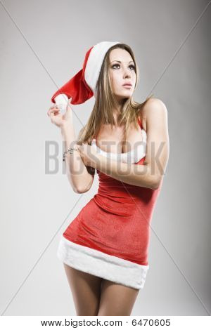 Studio Portrait Of Sexy Woman Dressed As Santa