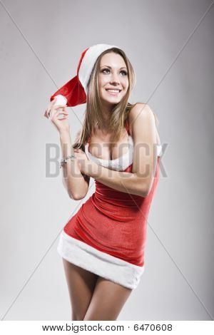Studio Portrait Of Sexy Smiling Woman Dressed As Santa