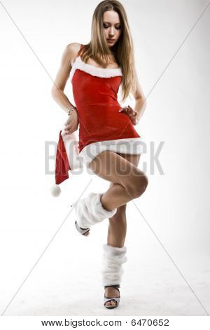 Portrait Of Beautiful Sexy Santa Girl Holding Cap