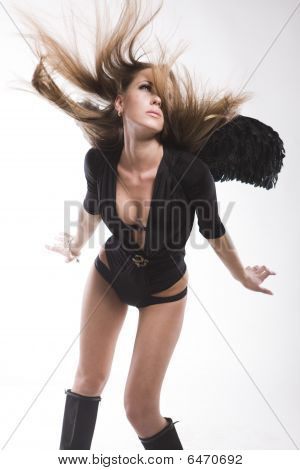 Sexy Woman With Black Wings And Hair Blown By Wind