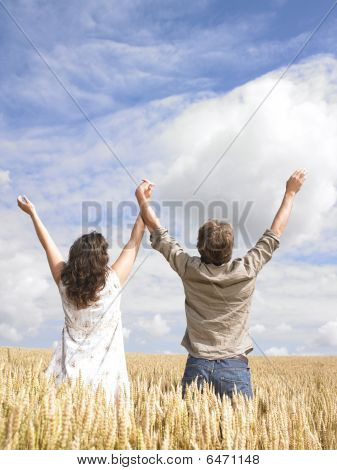 Couple Hugging In Wheat Field