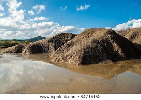 Rain water lake on mud volcano