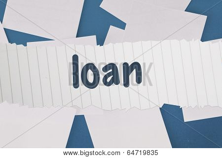 The word loan against white paper strewn over blue