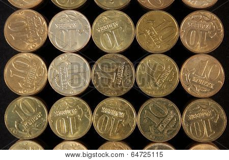 Coins stacked on a black background