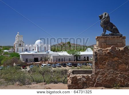 A carved stone lion keeps watch over the Mission in Tucson Arizona.