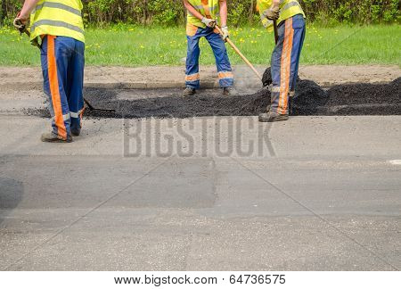 Teamworker Smoothing Asphalt Pavement New Road