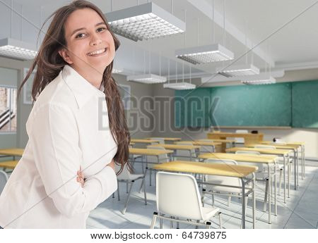 Smiling female  teacher in an empty classroom