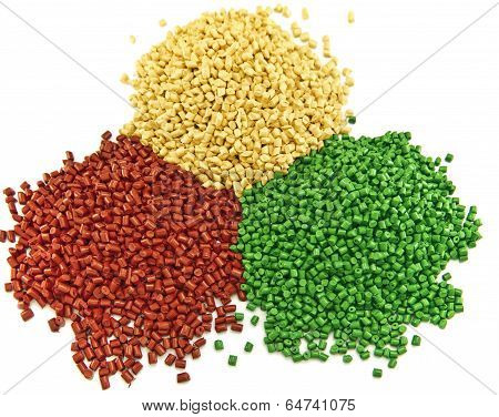 colorful plastic polymer granules isolated on white