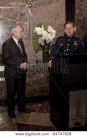NEW YORK-APR 21, 2014: Police Commissioner William Bratton and Lt Tony Giorgio at ceremony to light the Empire State Building to pay tribute to fallen NYPD officers in honor of Police Memorial Week.