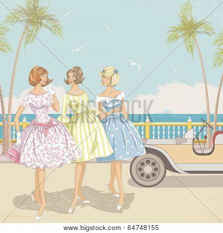 Three elegant women walking near the beach