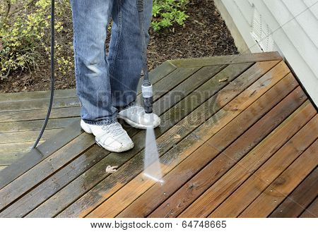 Man Using Power Washer