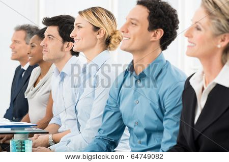 Close Up Of Smiling Multiracial Businesspeople Sitting In A Row