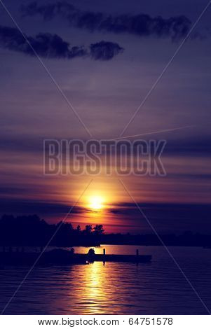 Sunset Over a Lake with Couple - Vertical