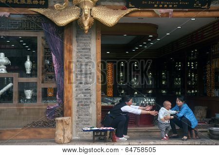 Daily Life On Souvenir Shop In Shuhe Ancient Town.
