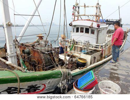 Fishermen Unload Their Catch