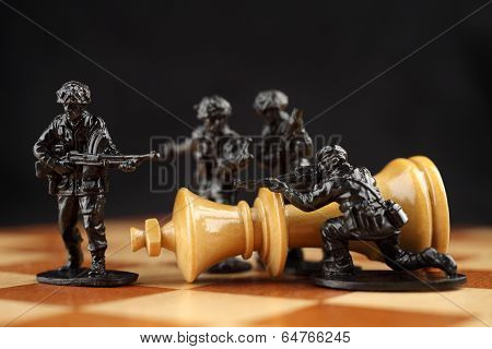 Toy soldiers kill chess King.