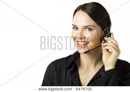 Attractive Woman With Headset Isolated Over White
