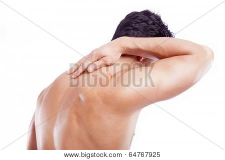 Muscular man holding his back in pain, isolated on white background