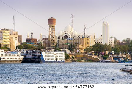 Aswan Christian Church With Nile River And Boats