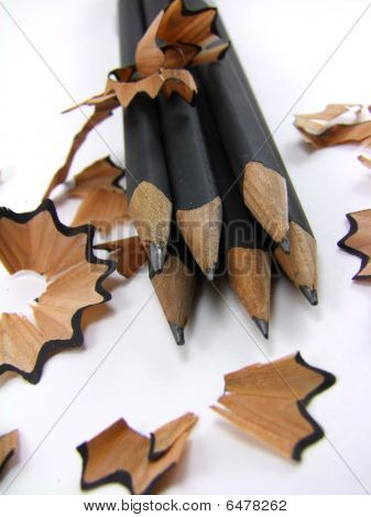 Sharpened pencils with shavings on white background - 1