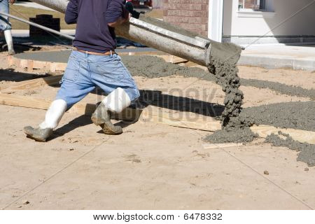Man Pouring Concrete