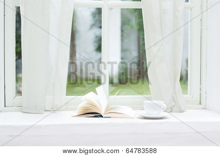 A books and coffee cup on furniture