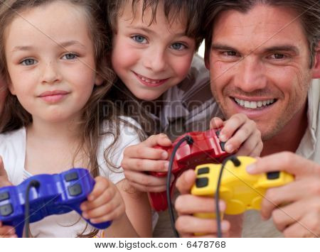 Happy Father And His Children Playing Video Games