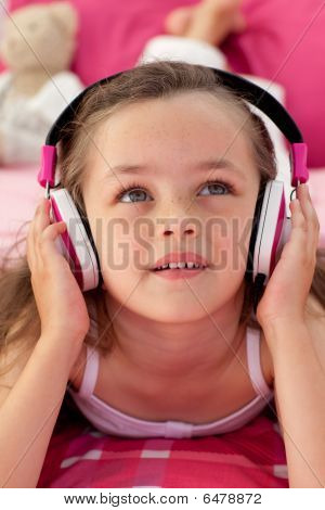 Close-up Of A Cute Girl Listening Musc