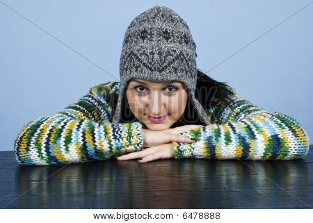 Girl In Wool Cap Sit With Head On Table