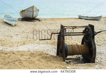 Fishing Boat Pulled At Shore With Trawler